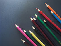 Imitation success. Business. Colored pencils on a black background Stock Image