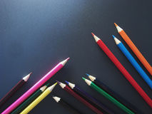 Imitation success. Business. Colored pencils on a black background Royalty Free Stock Photo