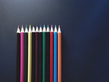 Imitation success. Business. Colored pencils on a black background Royalty Free Stock Photos