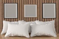 Imite encima de marco de la foto con las almohadas blancas en interior del sitio en la representación 3D Imagenes de archivo
