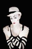 Imitieren Sie in gestreiften Handschuhen und im weißen Hut Stockfoto