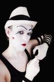 Imitieren Sie in gestreiften Handschuhen und im weißen Hut Lizenzfreie Stockfotografie