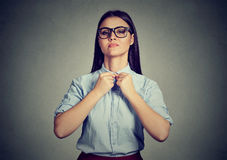 Immaculate woman buttons up her shirt Royalty Free Stock Photos