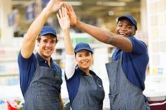 Immagazzini i lavoratori su cinque Immagine Stock