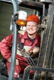 Immagazzini il driver del lavoratore in carrello elevatore fotografia stock libera da diritti