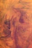 Immagine arancione astratta dell'inchiostro   Fotografia Stock