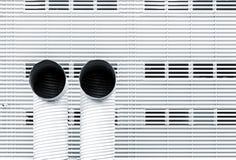 Immagine astratta di architettura con due tubi di ventilazione fotografia stock libera da diritti