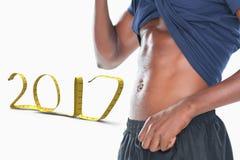 immagine composita 3D di metà di sezione di un uomo muscolare che mostra il suo ABS Fotografia Stock Libera da Diritti