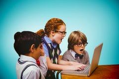 Immagine composita degli allievi che per mezzo del computer portatile Fotografia Stock Libera da Diritti