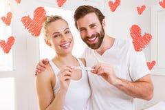 Immagine composita dei cuori 3d dei biglietti di S. Valentino e delle coppie Fotografia Stock