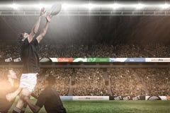 Immagine composita dei fan di rugby in arena Immagini Stock