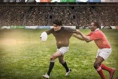 Immagine composita dei fan di rugby in arena Fotografia Stock