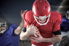 Immagine composita dei giocatori di football americano fotografie stock