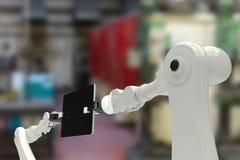 Immagine composita dei robot che tengono compressa digitale 3d Immagine Stock