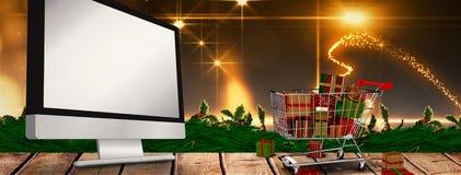 Immagine composita del carrello in pieno dei regali Immagini Stock