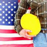 Immagine composita del casco della tenuta del lavoratore manuale Fotografie Stock Libere da Diritti
