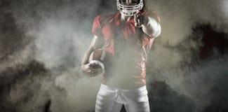 Immagine composita del giocatore di football americano che indica alla macchina fotografica Immagini Stock Libere da Diritti