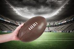 Immagine composita del giocatore di rugby che passa una palla di rugby 3D Fotografia Stock