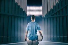 Immagine composita del giocatore di rugby che tiene una palla di rugby 3D Immagini Stock Libere da Diritti