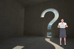 Immagine composita del giornale alla moda colpito della tenuta della donna di affari Fotografia Stock Libera da Diritti