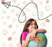 Immagine composita del globo sorridente della tenuta dell'allievo sveglio Immagine Stock