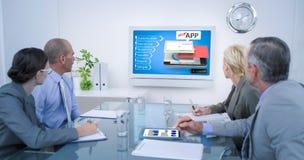 Immagine composita del gruppo di affari che esamina orologio marcatempo Fotografia Stock Libera da Diritti