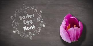 Immagine composita del logo di caccia dell'uovo di Pasqua contro un fondo nero Immagini Stock Libere da Diritti