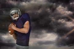 Immagine composita del manto di sport che getta la palla Fotografia Stock Libera da Diritti