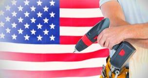 Immagine composita del midsection del carpentiere maschio con il trapano e la plancia Immagine Stock Libera da Diritti