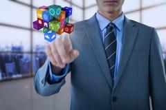 Immagine composita del midsection dell'uomo d'affari ben vestito che indica cubo Fotografia Stock