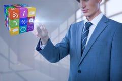 Immagine composita del midsection dell'uomo d'affari elegante che indica cubo Fotografie Stock Libere da Diritti