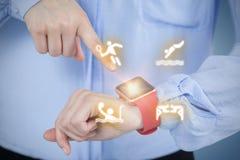 Immagine composita del midsection della donna di affari che indica all'orologio astuto Immagini Stock Libere da Diritti