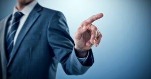 Immagine composita del midsection di indicare ben vestito dell'uomo d'affari Fotografie Stock