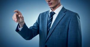 Immagine composita del midsection di indicare elegante dell'uomo d'affari Immagini Stock Libere da Diritti