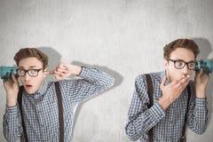 Immagine composita del nerd che ascolta di nascosto Immagine Stock