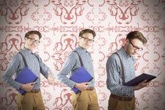 Immagine composita del nerd con il taccuino Fotografia Stock Libera da Diritti