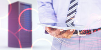 Immagine composita del punto di vista alto di fine dell'uomo d'affari facendo uso del computer della compressa Immagine Stock