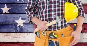 Immagine composita del riparatore con il casco ed il martello Fotografie Stock Libere da Diritti