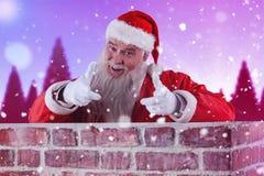 Immagine composita del ritratto del Babbo Natale felice che fa gesto di mano sopra la parete Fotografia Stock