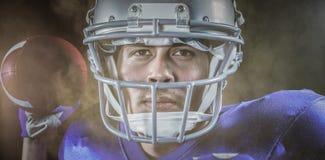 Immagine composita del ritratto del primo piano della palla della tenuta dello sportivo Fotografia Stock