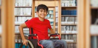 Immagine composita del ritratto del ragazzo che si siede in sedia a rotelle Fotografia Stock Libera da Diritti