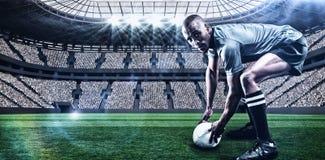 Immagine composita del ritratto della palla della tenuta del giocatore di rugby con 3d Fotografia Stock Libera da Diritti