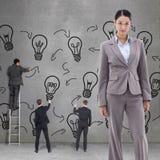 Immagine composita del ritratto di una posa castana della donna di affari Immagine Stock Libera da Diritti
