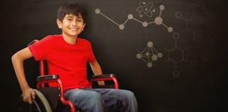 Immagine composita del ritratto del ragazzo che si siede in sedia a rotelle Fotografie Stock