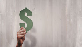 Immagine composita del simbolo di dollaro della tenuta della mano Fotografia Stock