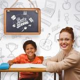 Immagine composita dell'allievo d'aiuto dell'insegnante Immagine Stock Libera da Diritti