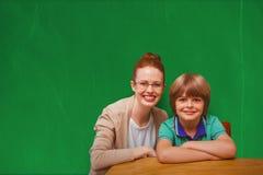 Immagine composita dell'allievo e dell'insegnante felici Fotografia Stock Libera da Diritti