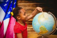 Immagine composita dell'allievo felice con il globo Fotografie Stock Libere da Diritti