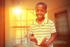 Immagine composita dell'allievo felice con il libro Immagini Stock Libere da Diritti