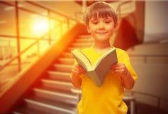 Immagine composita dell'allievo felice con il libro Immagine Stock Libera da Diritti